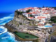 A cliff full of life (Sandra_R) Tags: ocean light sea summer cliff portugal water beauty stone landscape outdoors photography marine rocks waves quiet afternoon exterior bright hill sintra nobody typical viewpoint landforms clearsky clearwater purity nationalsymbols azenhasdomar travelerphotos goldenphotographer diamondclassphotographer flickrdiamond