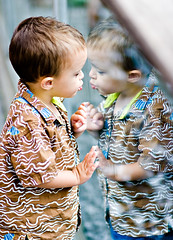 Narcissus Goes to the Zoo (Ryan Brenizer) Tags: nyc newyorkcity family boy newyork reflection cute zoo kiss fuji bokeh centralpark july noflash gothamist dougie 2007 85mmf14d s5pro
