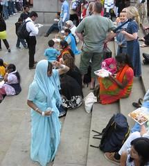 Hare Krishna tableau (rosewithoutathorn84) Tags: england people woman india london girl festival square hare pretty eating trafalgar socializing krishna sari