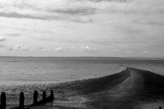 Spit (strife) Tags: sea sky blackandwhite bw beach pebbles groin titchfield