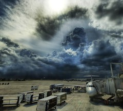 A Storm at the Airport (Stuck in Customs) Tags: pictures lighting light panorama art texture colors lines modern clouds composition work reflections painting photography airport intense nikon bravo perfect exposure shoot artist mood photographer shot angle florida photos unique background details d2x perspective atmosphere delta westpalmbeach images best edge processing pro framing capture airlines drama tones palmbeach hdr masterpiece treatment mostviewed highquality stuckincustoms treyratcliff holidaysvacanzeurlaub