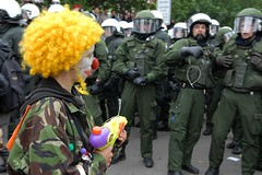 June 2: scared ?! (Hughes Lglise-Bataille) Tags: color topf25 germany fun topf50 nikon gun clown photojournalism police demonstration pistol summit d200 circa rostock 2007 g8 clandestineinsurgentrebelclownarmy topv1000 topv2000