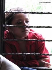 Village girl looking in (LifeStar7) Tags: nepal window girl children bars child pokhara villagers behindbars mosaicboston ironbars computercenter pokharanepal clothesdrive excapture nepalproject