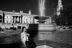 Pocket that (Gary Kinsman) Tags: life street shadow bw woman london fountain photography blackwhite candid trafalgarsquare highcontrast canon5d 2010 wc2 canon1740mmf4l