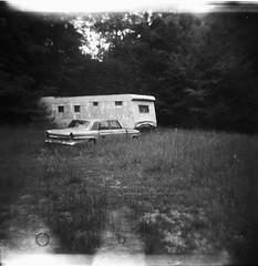 parked (birdcage) Tags: blackandwhite bw abandoned car mediumformat holga toycamera westvirginia parked trailer