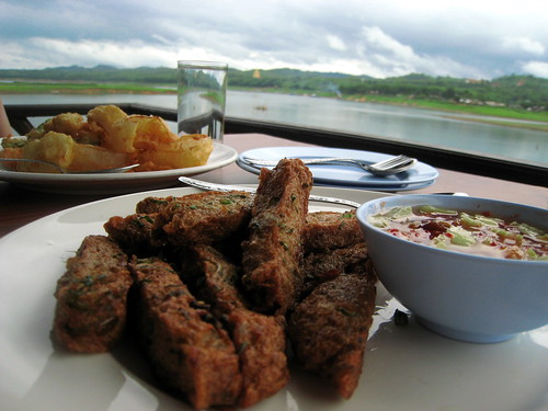 Fish cakes, tempura vegetables, and a view
