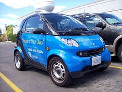 A Smart Car with a rooftop commode... (Steve Brandon) Tags: auto ontario canada car john advertising geotagged mercedes parkinglot automobile apartment ottawa rental toilet voiture suburb nepean properties smartcar dragonballz potty commode crapper stripmall germancar bluecar  subcompactcar foodbasics compactcar merivaleroad adsonwheels throneofyourown subsubcompactcar capsulecorp capsulecorporation transglobe merivalemarket cheminmerivale   propertymanagementservice