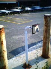 Abandoned parking lot gate thingo