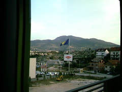 Samshop, Bosnian flag (Yakima_gulag) Tags: window out place im just where staying the