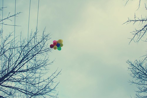 balloons in a gray sky.