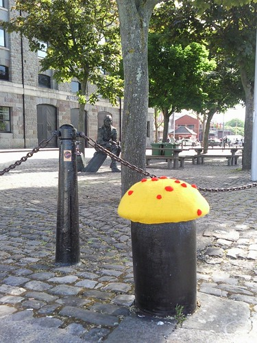 yellow and red yarn bomb mushroom