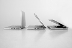 Evolution of the Apple laptop (Lloyd Hobden) Tags: apple computer notebook powerbook macintosh blackwhite mac portable g4 technology laptop side evolution minimal io intel titanium powerpc macbookpro