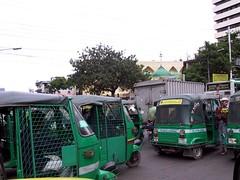 Green Rickshaws Stuck in Traffic