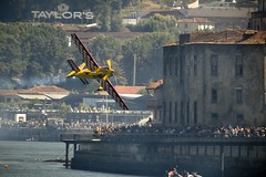 Air race (trazmumbalde) Tags: people portugal plane river crazy europe porto redbull stunt airrace