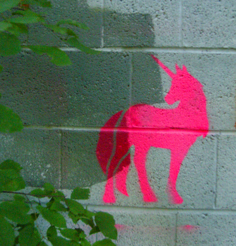 stencil graffiti of pink unicorn!