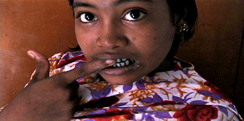 Halima brushes her teeth with ashes