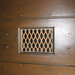 Window grate on door to Belltower Building Courtyard