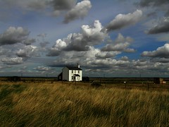 White House and Clouds, Dungeness. (TimBurnsArt) Tags: uk blue england sky cloud white house field grass weather clouds landscape kent interestingness view picture explore dungeness soe romneymarsh amazingtalent i500 naturewatcher