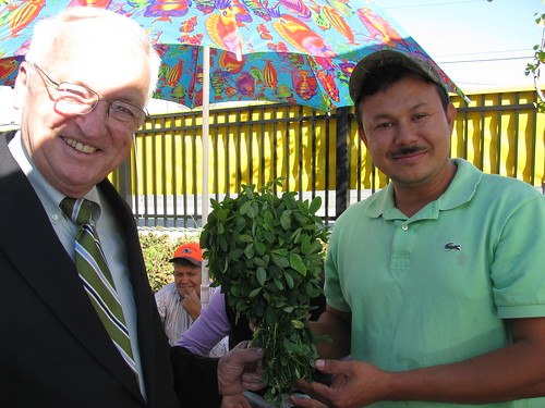 USDA Under Secretary Kevin Concannon poses with one of the many Maryland farmers (no name available) selling fresh produce at the Crossroads Farmers' Market in Tacoma Park, Maryland, Wednesday October 13.
