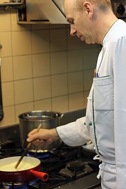 chef making fondue