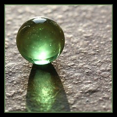 look into the future (Linda Cronin) Tags: light macro green glass interestingness explore sphere thumbsup gamewinner cy2 challengeyouwinner 3waychallengewinner 15challengeswinner lindacronin flickrelite motifdchallengewinner ljomi photofaceoffwinner likeitornotwinner a3b friendlychallengeswinner pregamewinner