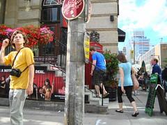 Another random shot of Toronto, Canada (Trinimusic2008 -blessings) Tags: street flowers summer sky toronto ontario canada june bar clouds corner standing buildings walking restaurant pub sitting random streetphotography billboard climbing signage to 2010 theatreposter capris shortsleeves concretepole whilestuckintraffic trinimusic2008 iwassittinginthepassengerfrontseatofacar
