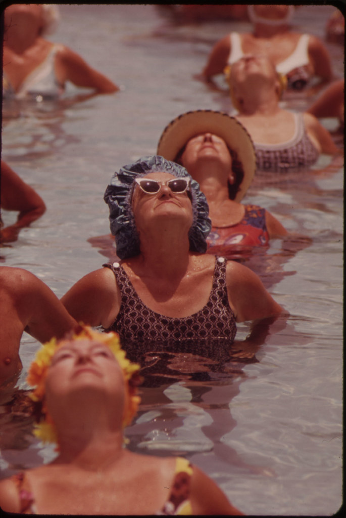 Residents Take Part in Organized  Daily Exercises in One of the Public Pools at Century Village  Retirement Community.