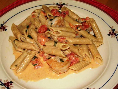 Shrimp in a creamy herb tomato sauce over penne