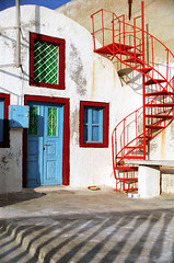 Oia Doors, No. 2 (h_roach) Tags: vacation fab tourism window vertical architecture stairs iron europe mediterranean doors shadows steps entrance nopeople santorini greece greekislands soe oia cyclades spiralstaircase thera tranquilscene blueribbonwinner traveldestination flickrsbest abigfave colorphotoaward diamondclassphotographer flickrdiamond outstandingtravelphotos