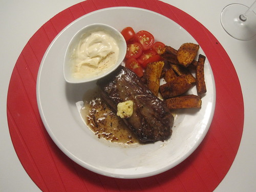 Steak with lemon butter, spiced sweet potato fries, tomato, spiced yogurt sauce