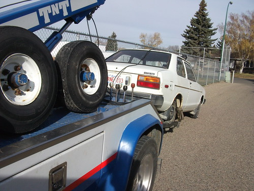 1981 Datsun 210 getting towed