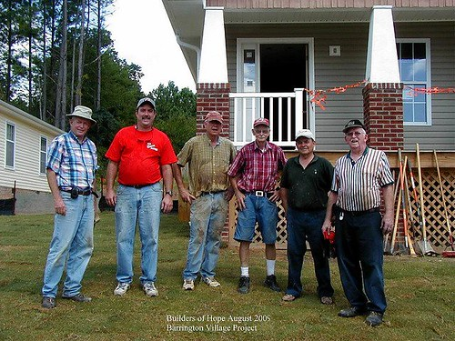 volunteers from Athens Drive Baptist Church in front of a home rehabbed by Builders of Hope (by: Builders of Hope)