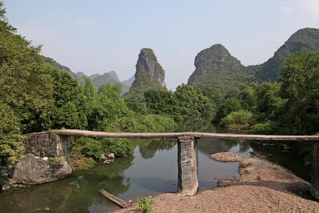 Karst mountain and a small bridge in Yangshuo, Guangxi, China