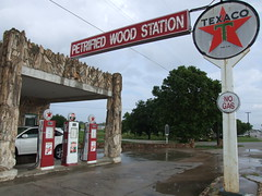 Petrified gas situation (Texas Finn) Tags: wood rain station shopping star construction texas palestine historic gasstation decatur gasoline texaco historicalmarker puddles souvenirshop smalltown petrifiedwood buildingmaterials oldgasstation newuse nogas