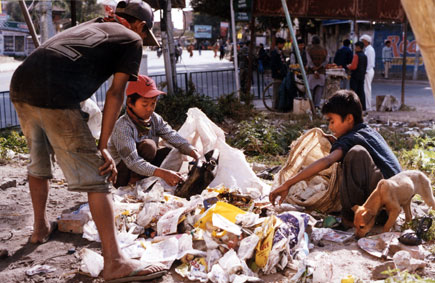Life, Street children in Kathmandu make a living by collecting plastic and metal waste and selling it to recycling plants, 2002 by Kashish Das Shrestha