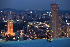 Infinity Pool_4981 (Andrew JK Tan) Tags: sky glass pool skyline night marina spectacular observation ir bay twilight nikon singapore couple cityscape view infinity sigma resort deck swimmer sands d3 attractions infinitypool panaromic mbs 70200mm integrated uniquelysingapore