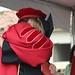 President Rush hugging graduate