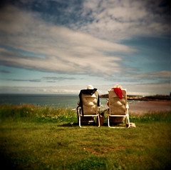 easy life (czuczy) Tags: flowers sky grass clouds holga contest cooler oldage fistralbeach threeco