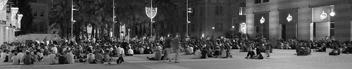 Israeli's listen to Eicha in Jerusalem's Kikar Safra, while sitting ></font></font></font> </p> <p> <font face=