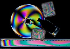 Digital storage (NavindaK) Tags: light white black colors rainbow colours spectrum plastic spectra lcd circular polarised