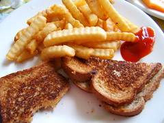 Grilled cheese and crinkle cut fries.