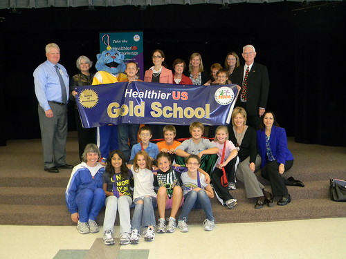 Lisa Pino celebrating with students at Phoenix Elementary in Grand Forks for earning a Gold award of Distinction in HealthierUS School Challenge
