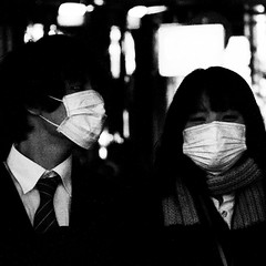 . (lazy_lazy_dog) Tags: street city light white black love japan contrast couple faces mask candid grain teens center osaka doubleportrait