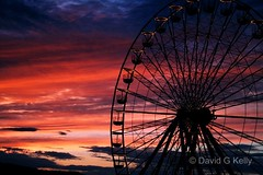 The Last Spin Of The Wheel (Dave G Kelly) Tags: carnival blue ireland light sunset sky water wheel silhouette night clouds digital canon 350d evening noche big twilight ride dusk competition fair ferris irishindependent independent farewell winner noite ferriswheel bigwheel wicklow funfair canoneos350d indo notte bray dublino irlanda irlande peopleschoice dubln supershot 1855lens supershots superaplus aplusphoto superhearts unseenireland davegkelly