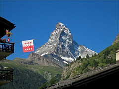 swiss national day (Ron Layters) Tags: mountain nature digital canon geotagged switzerland interestingness searchthebest flag explore digitalcamera zermatt matterhorn wallis august1 valais cervin pentaxmz10 cervino greatweather mountainsalps swissnationalday elevation40004500m altitude4478m summitmatterhorn flickrfly montcervin 4478m mattertal ronlayters 14692ft canonixuswireless valaisflag geo:lat=459771 geo:lon=765912 highestpositioninexplore428onsaturdayaugust182007 bachspicsgallery