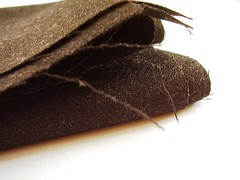 soft folds (a thousand black dreams) Tags: italy wool fabric charcoal cashmere folds stacked piles