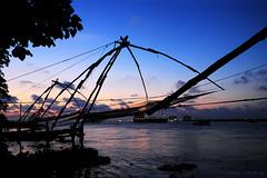 Fort Cochin (Vinod Kumar M.) Tags: sunset sea sky india canon landscape evening fishing ship silhouettes fishnet kerala kochi vino vinod fortkochi chinesefishnets canon50d vinodkumar chinesefishnet canonefs18135mmf3556is vinodkumarm vinodkumarmphotography