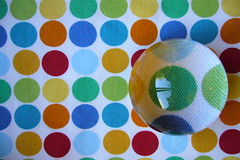 Dots (BrianinLR) Tags: blue red orange green colors yellow lens magnifyingglass fabric dots magnify polkadot