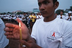 A campaigner holds a candle for HIV/AIDS victims at a rally (World Bank Photo Collection) Tags: sunset man asia cambodia candle hand rally flame health gathering worldbank hivaids eastasia