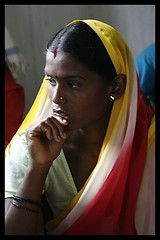 In thought... (Prshant  Bhrdwaj) Tags: red people woman india color colour beauty yellow canon one thoughts thinking om saree ask prashant chattisgarh chhattisgarh 400d ambikapur 50millionmissing prashantbhardwaj askindiaorg